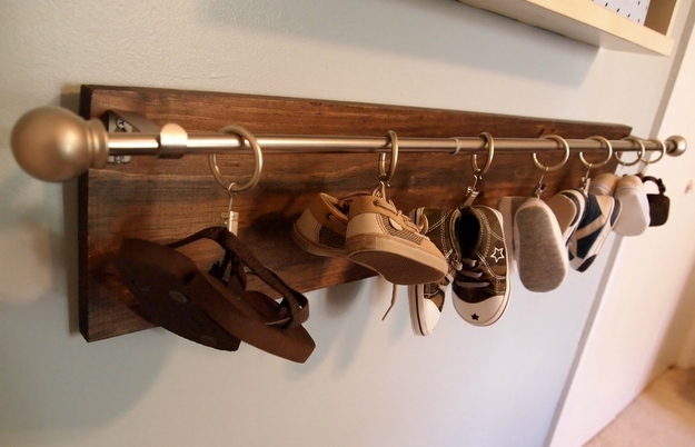 Hang-baby-shoes-on-a-curtain-rod.