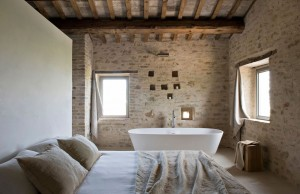 drop-dead-gorgeous-scenic-inspiring-brown-exposed-brick-wall-for-bedroom-white-wall-paint-glass-windows-white-bathtub-white-bed-sheet-brown-pillows-br